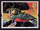 UNITED KINGDOM - CIRCA 1993: A stamp printed in Great Britain shows Long John Silver and Parrot (Tre