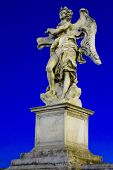 One Of Bernini`s Statue Of Angels (angel With The Superscription) On Ponte Sant`angelo, In Front Of