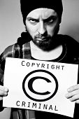 stock photo of cheater  - Portrait of man arrested for violating copyright laws - JPG