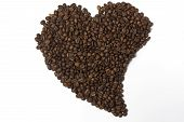 Coffee beans lined in the shape of heart