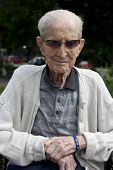 Portrait Of Smiling Senior Man In Sunglasses