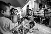 BERDUT, MALAYSIA - APR 8: Unidentified children Orang Asli in his village (b/w photo) on Apr 8, 2013
