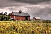 Barn Under Stormy Skies.