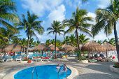 PLAYA DEL CARMEN, MEXICO - JULY 13: Scenery of luxury swimming pool at RIU Yucatan Hotel  in Playa d