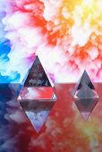 Magic Pyramids Against Abstract Background.