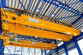 image of crane hook  - Yellow factory double girder overhead crane in plant - JPG