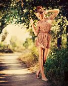 Beauty Romantic Girl Outdoor. Beautiful Teenage Model Dressed in Fashionable Short Dress Posing Outd
