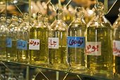 Closeup of bottles of essential oils used in perfume making displayed in a row