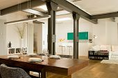 stock photo of koln  - Dining room with view of bar and living area in the background at modern home - JPG