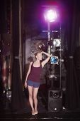 Full length of a young woman standing backstage