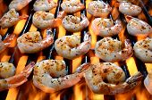 picture of shrimp  - Delicious Shrimp on a grill cooking over an open flame - JPG