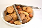 stock photo of pecan  - Walnuts Brazil nuts Almonds Hazelnuts and pecans in a white bowl - JPG