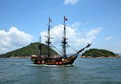 stock photo of historical ship  - Historic old ship in the ocean near the islands - JPG