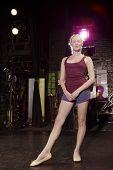 Full length portrait of a confident young ballet dancer backstage