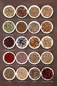 Medicinal herb selection also used in witches magical potions over brown lokta paper background with titles.
