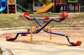 picture of seesaw  - Colorful seesaw on a playground in a sunny day - JPG