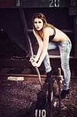 Beautiful Young Girl In Bra And Jeans Pulls The Railway Lever