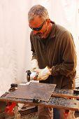 Builder Cutting Floor Tile
