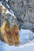 vintage wooden Bear Paw snowshoes in Colorado winter landscape