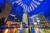 BERLIN, GERMANY - SEPTEMBER 20, 2013: The fountain at night in Sony Center.The center is a public space located in the Potsdamer Platz financial district.