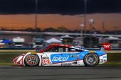 Daytona Beach, FL - Jan 25, 2014:  The Telcel Ford EcoBoost travels through the turns during Rolex 2