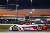 Daytona Beach, FL - Jan 25, 2014:  Action Express Racing travels through the turns during Rolex 24 a