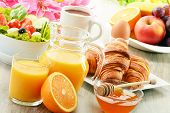 pic of fruit-juice  - Breakfast with coffee orange juice croissant egg vegetables and fruits