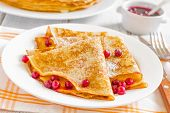 stock photo of tuesday  - Shrove Tuesday pancakes with berries on a plate - JPG