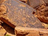 pic of valley fire  - Ancient drawings on snadstone rock at Valley of Fire State Park Nevada - JPG