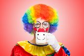 Clown drinking from a cup