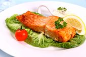 Salmon Fillet With Salad, Tomato And Lemon