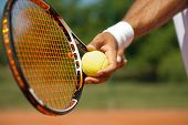 foto of stand up  - Close up of a tennis player standing ready for a serve - JPG