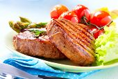 Постер, плакат: Steak Grilled Beef Steak Meat with Vegetables Asparagus Cherry Tomato and Lettuce Steak Dinner
