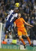 BARCELONA - JAN, 12: Xabi Alonso(R) of Real Madrid vies with Jhon Cordoba(L) of RCD Espanyol during