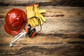 picture of protective eyewear  - Personal Protective Equipment on rustic  floor boards - JPG