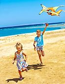 foto of kites  - Child flying kite beach outdoor - JPG