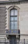 Balcony and window of Louvre building in Paris