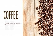Roasted Coffee Beans Background Texture On Wooden Board Frame Isolated On White Background With Copy