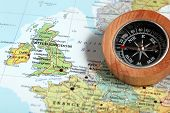 image of ireland  - Compass on a map pointing at United Kingdom and Ireland planning a travel destination - JPG