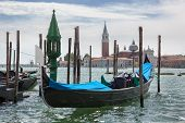 Gondolas and San Giorgio Maggiore church on Grand Canal in Venice