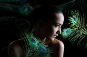stock photo of female peacock  - Beautiful brunette young woman with peacock style make - JPG