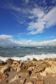 The Mediterranean coast. Azure waves and spectacular bizarre clouds