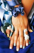blue manicure with ribbon close up