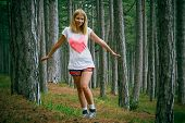 Young Woman Walking In Coniferous Deep Forest Beautiful Green Summer Landscape Outdoor Lifestyle