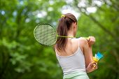 Sport Woman With Badminton Racket And Shuttlecock In The Park