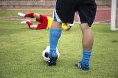 Soccer Player Shooting