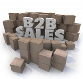 B2B Sales words in 3d letters surrounded by cardboard boxes as orders to companies of goods and prod
