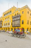 LIMA, PERU, MAY 23, 2014 - Horse drawn carriage waits for tourists in Plaza Mayor