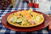 stock photo of iceberg lettuce  - A chicken breast salad with iceberg lettuce cheddar cheese and cucumbers on a picnic table - JPG