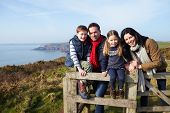 Portrait Of Family Walking Along Coastal Path